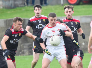 Louth goalscorer Conal McKeever surrounded by Down players